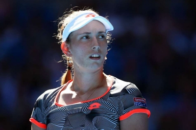 Mertens fights back to beat Halep in Doha