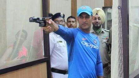 Dhoni tests his marksmanship