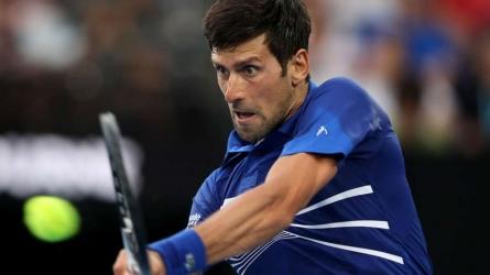 Dominant Djokovic coasts through