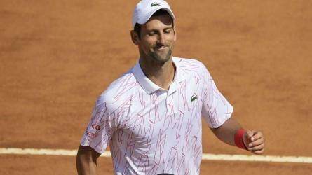Djokovic back with a win