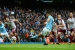 Aguero levels record as Man City stretch lead